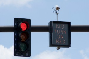 Can running a red light jack up your car insurance rates with a simple picture?