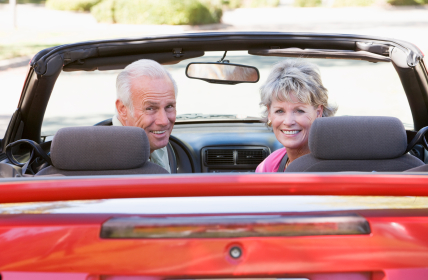 Older couple in convertible car.