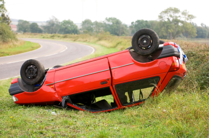 red car upside down after accident