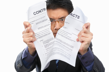 chinese businessman tearing up contract