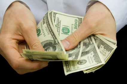 Man's hands holding cash.