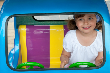 Girl Driving Toy Car