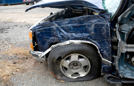 A damaged vehicle needing collision insurance