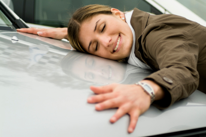 Woman Hugging Her Brand New Car
